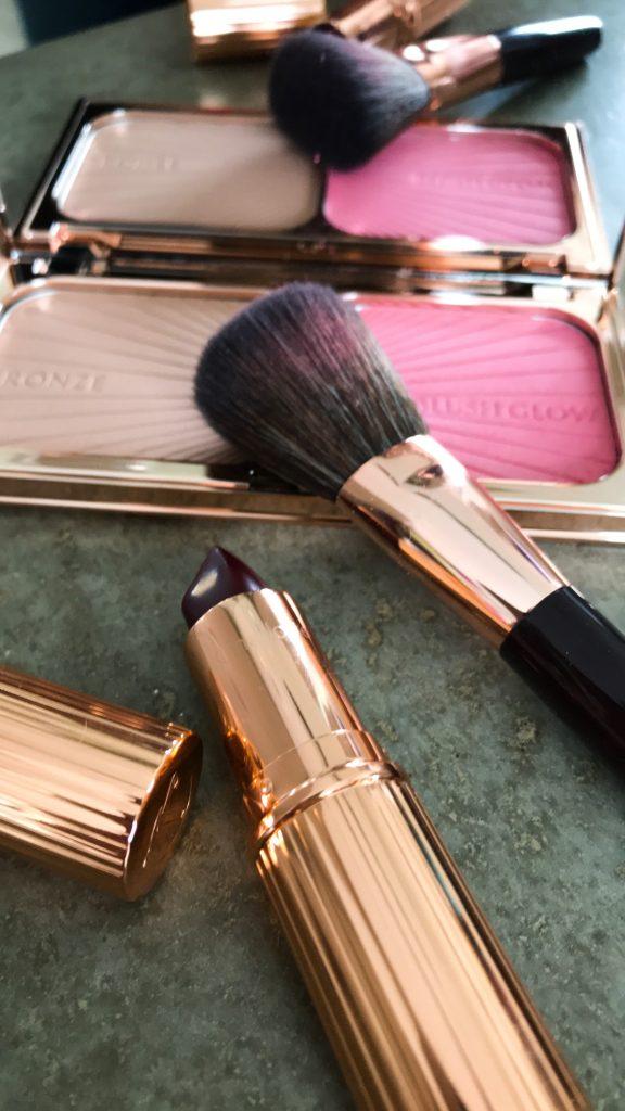 Charlotte Tilbury Filmstar bronze & blush glow and matte revolution lipstick in Opium Noir